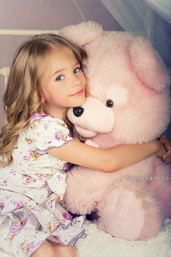 Cuddled with Teddy Bear::