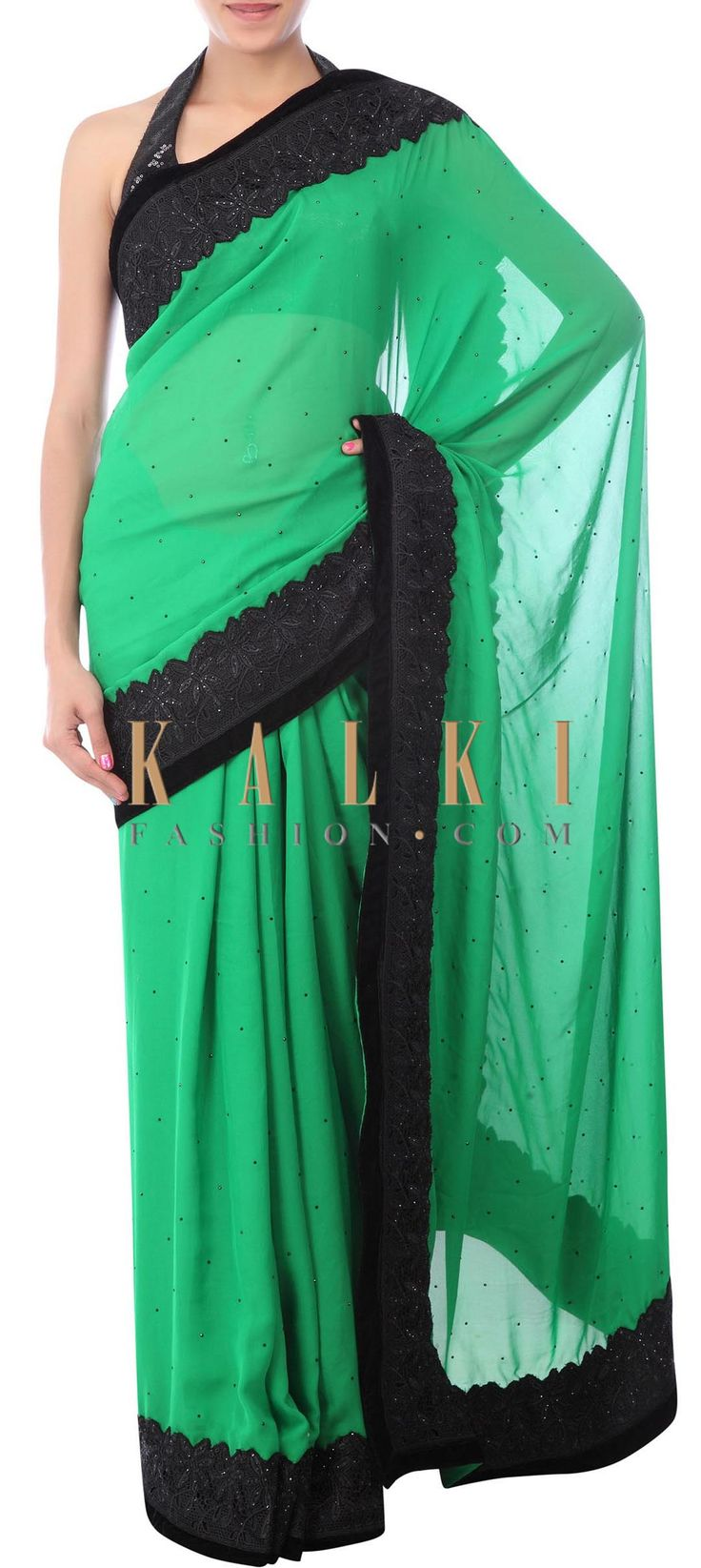Buy Online from the link below. We ship worldwide (Free Shipping over US$100) http://www.kalkifashion.com/breen-saree-adorn-in-blakc-cut-work-lace-only-on-kalki.html