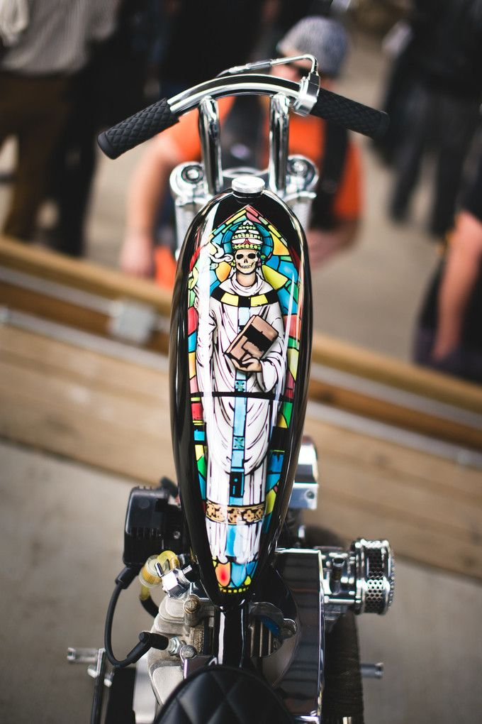 shovelhead custom with super skinny window bars and stained glass death pope paintjob on super skinny gas tank