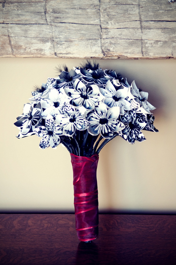 My wedding bouquet. Satin stemmed paper flowers with black feather centers. (photo by Christi Falls)Paper Flower