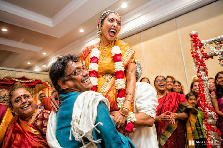 part of an Indian wedding ceremony where uncles lift the bride and groom to exchange garlands....