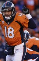 Denver Broncos quarterback Peyton Manning (18) calls an audible at the line of scrimmage against the San Diego Chargers in the first quarter of an NFL AFC division playoff football game, Sunday, Jan. 12, 2014, in Denver. (AP Photo/Charlie Riedel) final score Denver 24 / San Diego 17