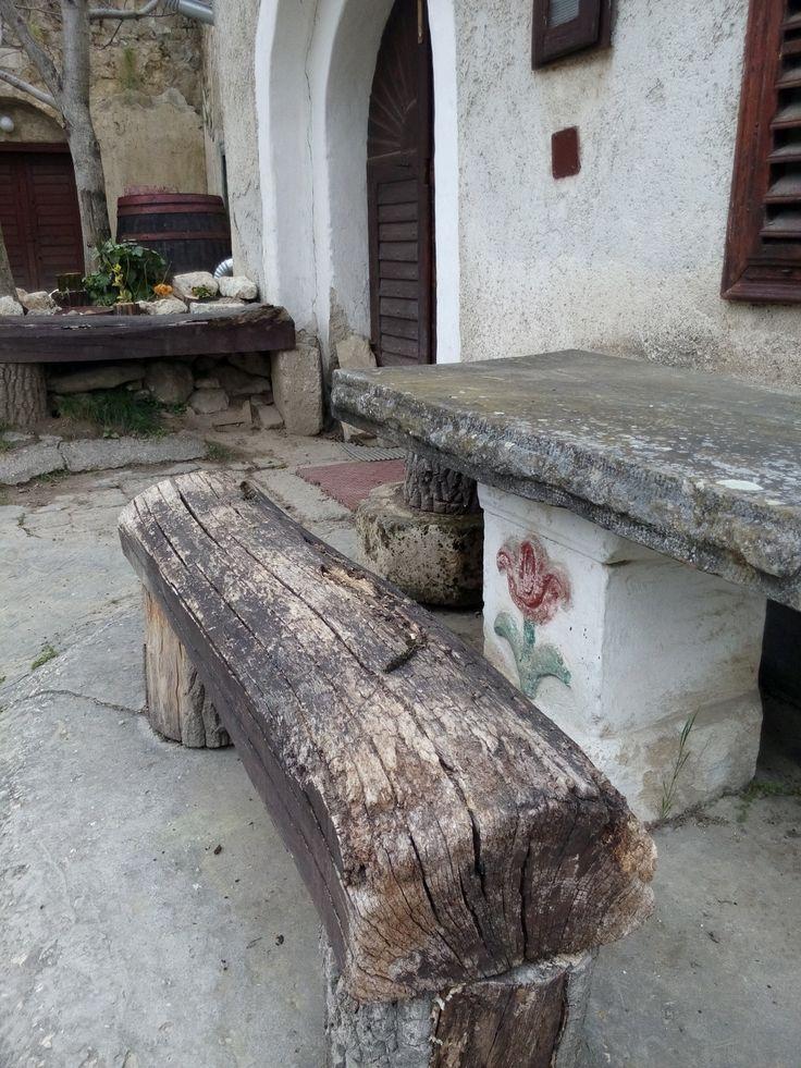 An old bench outside a wine cellar in Tök.