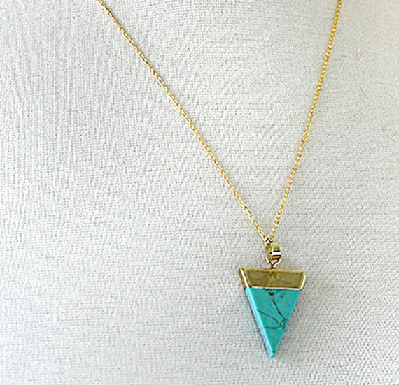 A triangle necklace, or some call it a V necklace, is trendy and stylish. It is simple and minimal and makes a great layering necklace with other jewelry. This beautiful teal and gold triangle necklace makes a strong feminine statement on its own too.  The top of your triangle necklace is gold plated and hangs on a simple and delicate 24K gold plated brass chain. The chain is approximately 20 5/8 long including the lobster claw clasp. The triangle is approximately 1 5/8 long. The t...