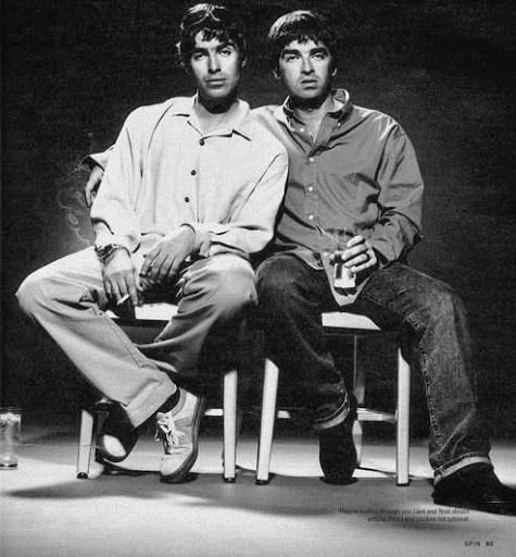 Liam Gallagher and Noel Gallagher on some chairs