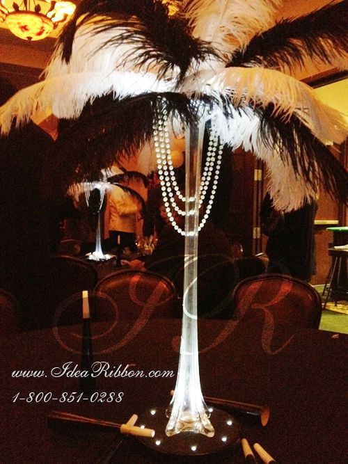 Old Hollywood guest table centerpieces? love how it seems to symbolize/resemble a slender woman wearing a feather hat and pearls!