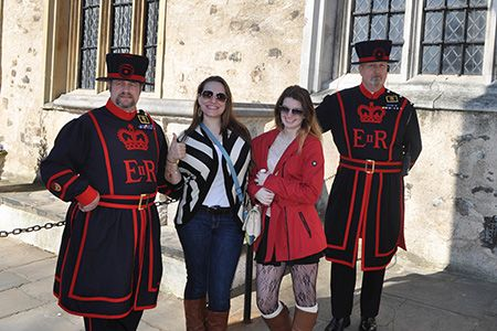 Hailey Skopas and Kelly Blake with Tower of London guards during a Study Abroad trip to London in March 2014.