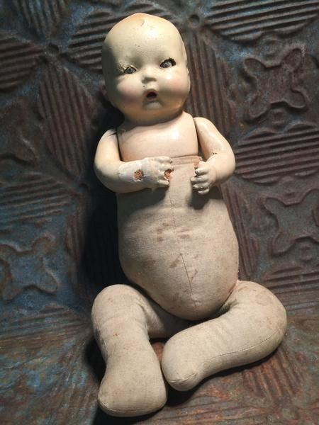 Vintage 1930's Creepy Baby Doll... Yeah, not sure what we were thinking with this one! Scare the crap out of your love ones with this delightfully creepy doll.