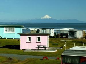 Taranaki Holiday Houses (Baches). Seaview Campground near Mokau