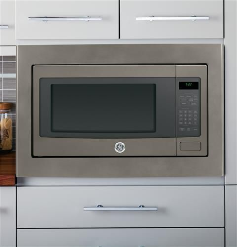 "This spacious countertop microwave oven features an extra-large 16"" turntable and one-touch operation, including an automatic defrost based on food weight."
