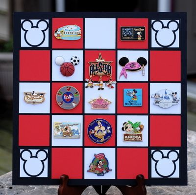 It's hard to figure out what to do with all those pins after your Disney World Vacation.  They're far too neat to just stash away in a drawer or box.  Cute Disney Pin Board - good idea for displaying pins.