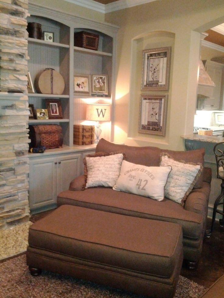 Chair in caddy corner with shelf next to it n deco pics above shelf and window on other side... Good sitting area for reading