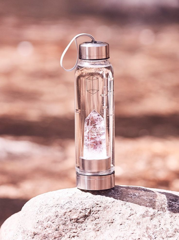 Crystal Elixir Water Bottle | Promote positivity and purification into your daily routine with the all-natural, energizing effects of raw crystals. A pure crystal stone is firmly fastened inside each glass bottle, creating an elixir that supports revitalization and clarification of the mind and body. Why do mountain streams taste so good and are so rejuvenating? It's because of they are natural elixirs!