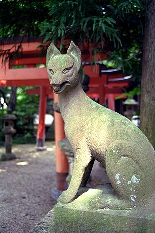 Kitsuni (Fox) Guardian Statue. Carved Stone. Inari Shrine.