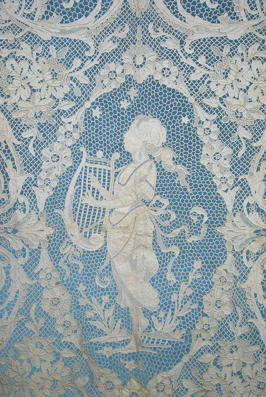 Another amazing tablecloth for sale on ebay: ANTIQUE ESTATE EXTRAVAGANT FIGURAL POINT DE VENISE LACE TABLE CLOTH