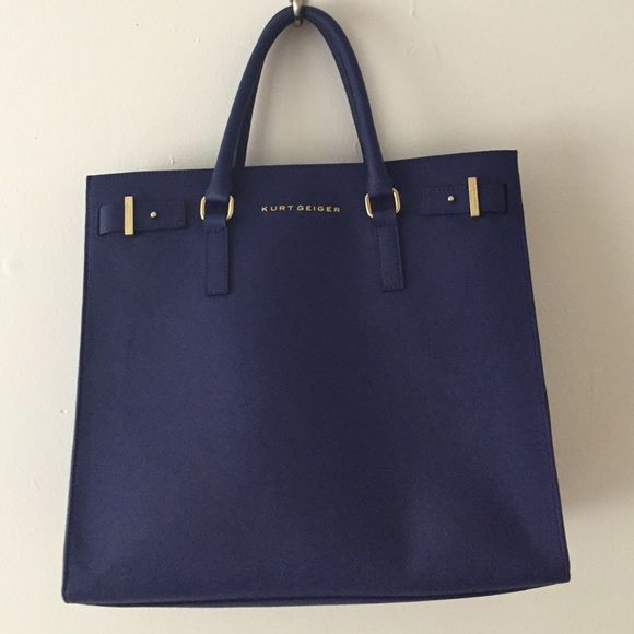 Kurt Geiger handbag Blue. Excellent condition. Tiny scratch on the gold detail. Tried to capture it here but it's quite small so may not eve may noticeable. I love this bag. Goes with everything! Lots of pockets and dividers. Kurt Geiger Bags