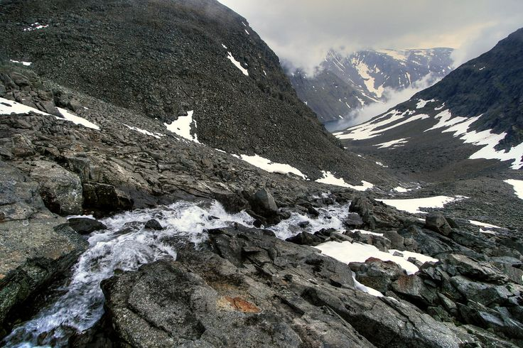 Ice melt forms an impromptu waterfall over the scree while descending from Kebnekaise, Sweden's highest peak at 2,111 metres (6,926 ft).  Sitting in the Scandes (Scandinavian Mountains) at 67°53″ North, Kebnekaise lies within the Arctic circle and experiences 24 hour daylight during the summer months.  Sweden