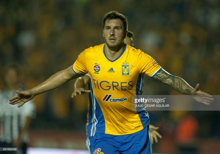 Tigres' Andre Pierre Gignac celebrates after scoring against Monterrey during the first leg of the Mexican Clausura 2017 tournament football quarterfinal match at the Universitario stadium in Monterrey, Mexico, May 10, 2017. / AFP PHOTO / Julio Cesar AGUILAR
