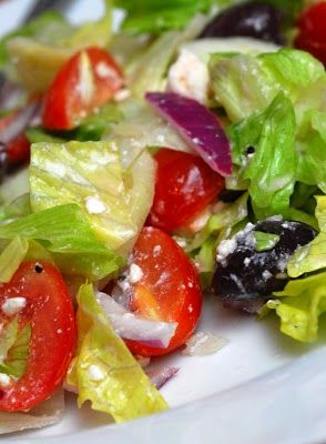 Martha Stewart's Greek Salad - Crisp greens, kalamata olives, cherry tomatoes, red onion, feta cheese & a great homemade dressing. YUM!