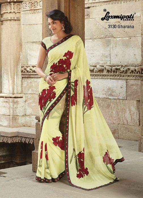 Brightest look ! The lemon yellow marvel chiffon saree with red bunch of flowers' prints & with dotted printed blouse.
