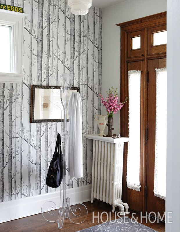 Woodsy wallpaper by Cole & Son lends a rustic note to even the slickest city homes. | Photographer: Stacey Brandford | Designer: Karen von Hahn