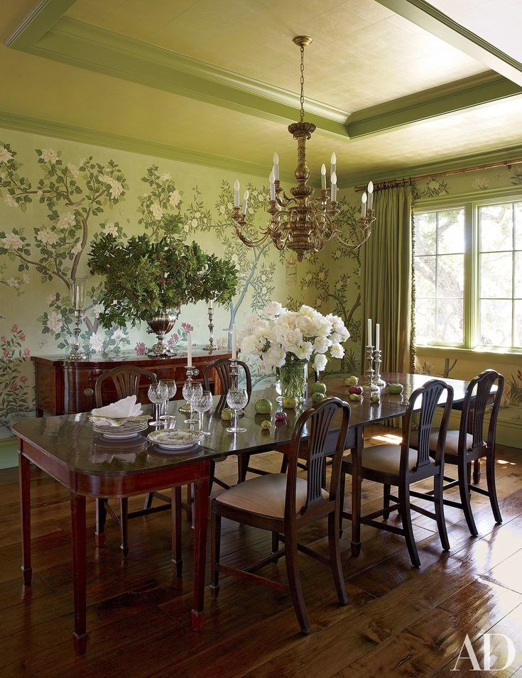 A Gracie Chinoiserie Wallpaper Wraps The Dining Room Which Is Furnished With An English Table And Chairs Gilt Wood Chandelier By Vaughan