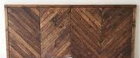 Solid wood herringbone headboard for Queen Size bed. Comes ready to install on any standard queen size frame. Medium stain applied to wood.