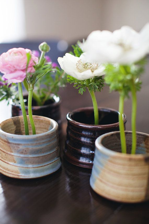 i LIKE these for centerpieces or home decoration. I could make my own pots in a pottery class or with my own clay and then use them as vases / flower pots.