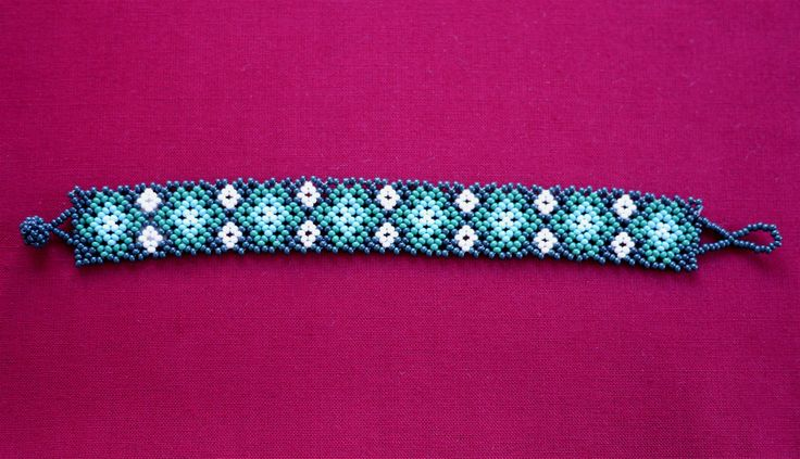 MEXICAN FLOWERS BEADED BRACELET - GREEN & LIGHT BLUE   ★ Mexican beaded bracelet, with flower path in dark green, medium green, two shades of light blue, and white. It's simple to wear; it just easily rolls over your hand and is very comfortable. ★ This beaded work is made by Mexican families. ★ You can combine it with various styles!
