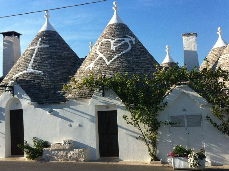 Alberobello, the Trulli houses with Pagan symbols on the roofs.