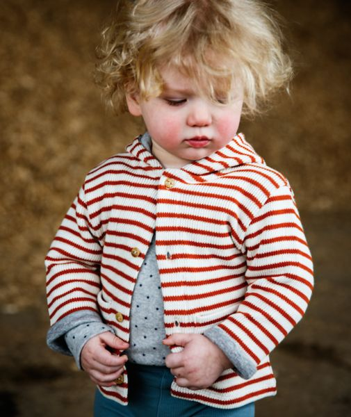 Claude & Co Sweats + Cardigans || Claude and Co UK Unisex Gender Neutral Childrenswear Baby Brand. Shop the collection www.claudeandco.co.uk. Online concept store stock branded clothing, toys, books, gifting and own brand. Baby Orange Stripe Knit Cardigan - Photoshoot own brand.