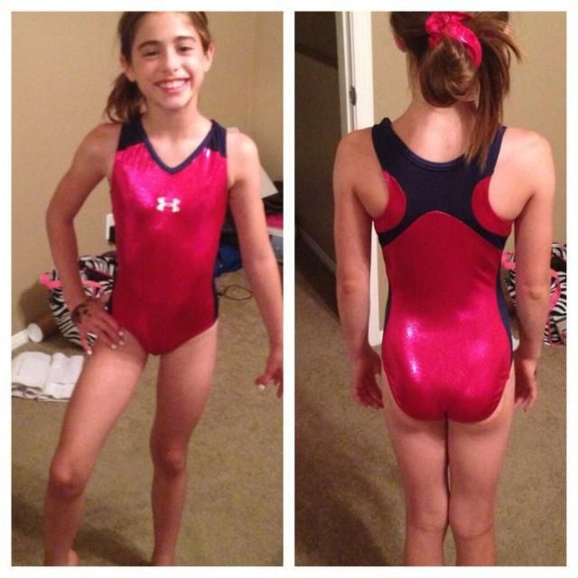 """Young gymnasts and sisters, Isabella and Daniella """"Dani"""" L. share the love for their new Under Armour gymnastics leotards."""