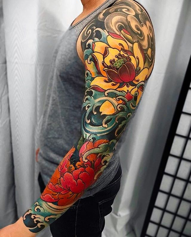 Japanese tattoo sleeve by @fibs_. #japaneseink #japanesetattoo #irezumi #tebori #colortattoo #colorfultattoo #cooltattoo #largetattoo #armtattoo #tattoosleeve #flowertattoo #peonytattoo #lotustattoo #newschool #newschooltattoo #wavetattoo #naturetattoo