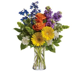 """Buy """"Beautiful Day"""" for $94.95. Refresh The Senses With The Splendour Of This Colourful Blend Of Gerberas, Roses, Stock, Delphinium And Bells Of Ireland In A Vase.  Flowers Are Subject To Seasonal Availability. In The Event That Any Of The Flowers Are Unavailable, The Florist Will Substitute With A Similar Flower In The Same Shape, Style And Colour. Stem Count, Packaging And Container May Vary. Standard (pictured Price) : A44v"""