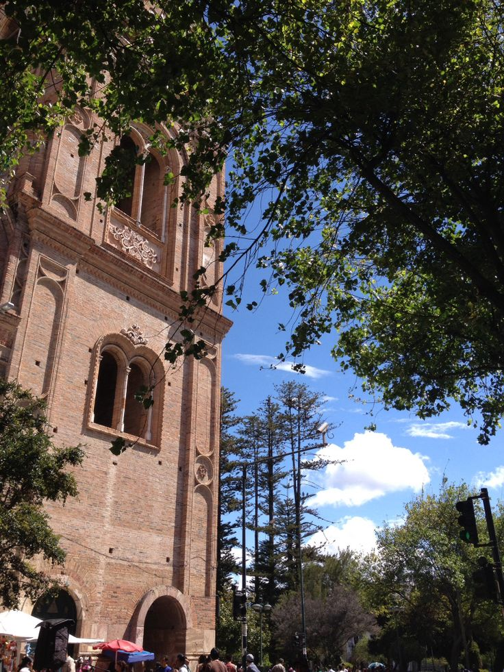 A beautiful day in downtown day in historical Cuenca, Ecuador. The New Cathedral overlooks Don Colon's restaurant.