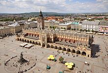 (Economy)  This picture show the main square in Krakow, Poland, it is a big tourist attraction. There are many shops, stores, restaurants, and street vendors. It is a big part of Poland's economy.