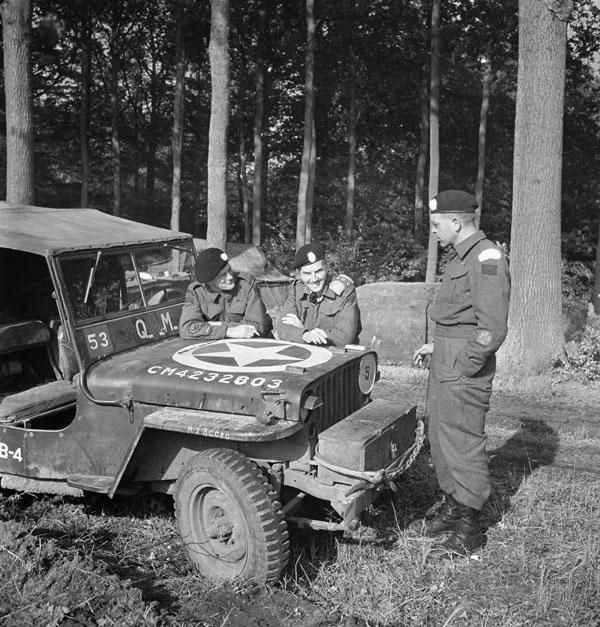 Personnel of the British Columbia Regiment with a jeep, near Brasschaet, Belgium, October 14th 1944.  (Left To Right): Regimental Quartermaster-Sergeant Harold Davies, Captain F.C. Smith, Regimental Sergeant-Major Ralph Jay.