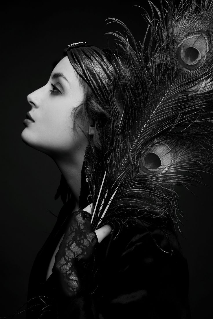 Whether it's the black and white, the pose, the scarf, or the peacock feathers, this image captures the 1920's-30's very well. I quite like it. The richness of the dynamic range is technically beautiful as well. Photo by Louise Ebel, after a photo of Gloria Swanson.