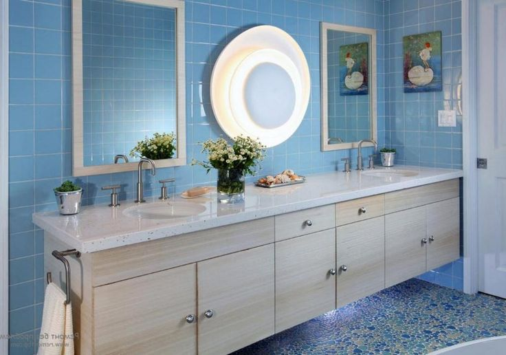 http://www.drissimm.com/wp-content/uploads/2015/02/retro-blue-bathroom-interior-design-with-blue-tile-wall-including-elegant-pattern-floor-as-well-wooden-vanity-plus-chest-drawer-underneath-and-mirror-on-the-wall.jpg