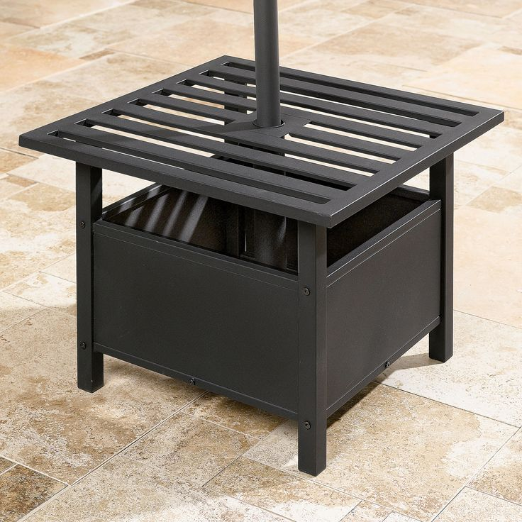 Square and sturdy, our Umbrella Stand Side Table is perfect for holding drinks and snacks. As an outdoor side table, it features a center hole with a steel tube to accommodate a standard patio umbrella. Its durable powder-coasted steel frame helps it withstand outdoor elements. For more outdoor ready end tables and furniture, check out BrylaneHome.com's outdoor living section.  • Powder-coated steel frame • Steel tube beneath accommodates standard patio umbrell...