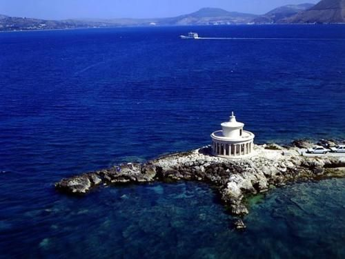 The lighthouse of Agioi Theodoroi ~ Region of Lassi near Argostoli of Kefalonia.