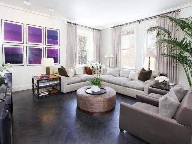 white living room with dark hardwood floors and beige suede sectional couch