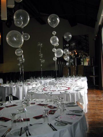 Different size balloons with long strings. Could be a good idea for those high ceilings that are hard to decorate.