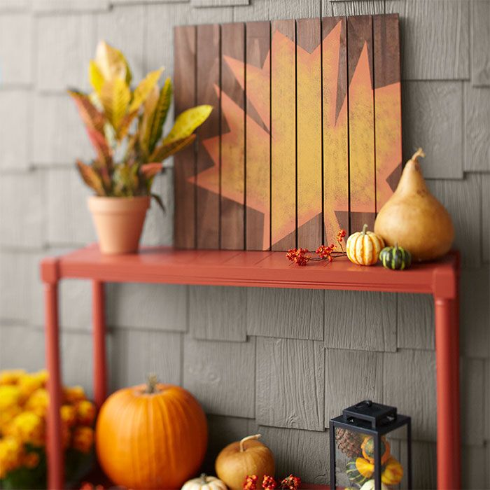 Bring an artistic flourish to your outdoor space with this DIY autumn leaf artwork. It's easy to assemble and there's no cutting required! Just stain craft boards and glue them into a square. Then trace a leaf shape on the boards and paint the leaf in a different color. Cost is about $30.