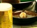 elgourmet.com - Cordero almendrado con espárragos, buñuelos de cangrejo y ensalada mexicana