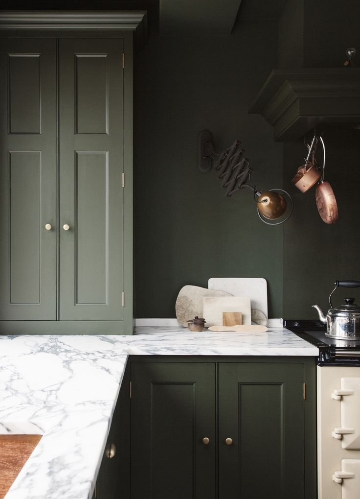 green kitchen cabinet and matching wall colour...