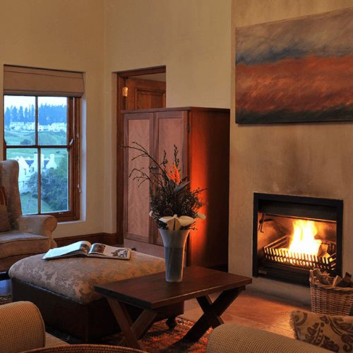 Our Luxury One Bedroom Suite features an indoor fireplace.