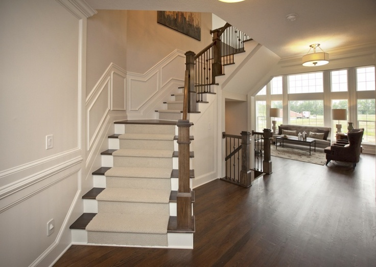 Open Staircase Design with Wainscoting by 3 Pillar Homes