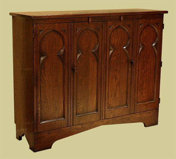 Oak TV cabinet Gothic style with bi-fold doors.