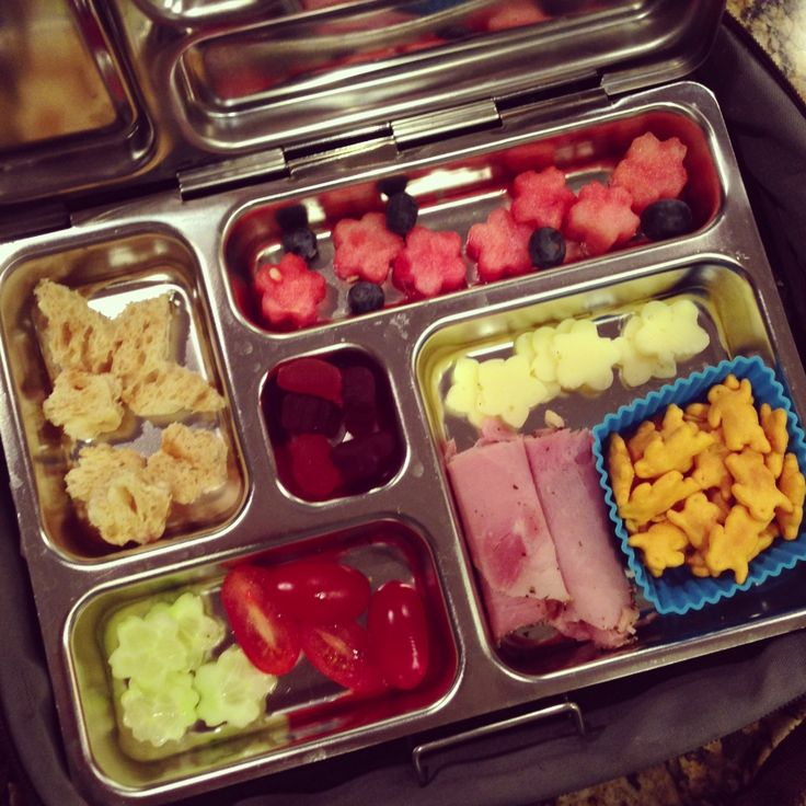 Wish I had one of these awesome lunchboxes from Planet Box for Lexie.  She eats like a bird and this would certainly give her more variety.